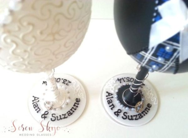 Hand painted bride and groom wine glasses for a Scottish wedding with tartan waistcoat and personalised with names and wedding date.