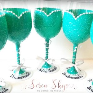 Personalised bridesmaids wine glasses thank you gifts with turquoise dress and names.