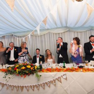 Champagne toast at the wedding breakfast with personalised champagne flutes.