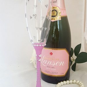 Personalised mother of the bride champagne flute with little hearts and name on the base.