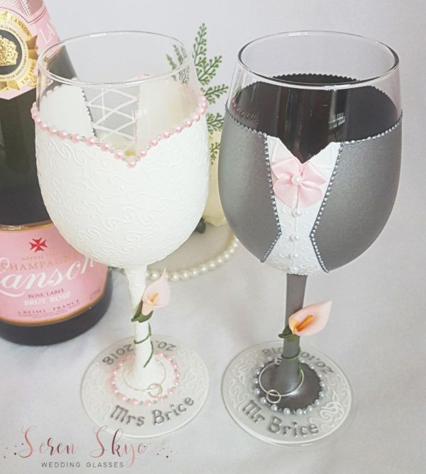 Bride and groom personalised wine glasses with grey suit and blush pink colour scheme.