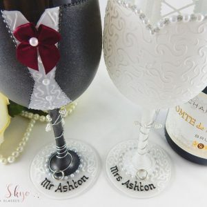 Personalised bride and groom wine glasses with charcoal suit and burgandy colour scheme.