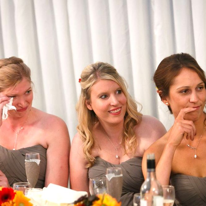 Bridesmaids with hand painted personalised glasses at wedding