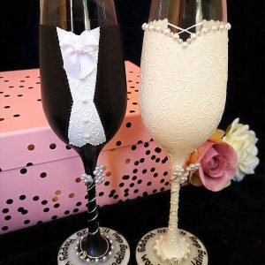 Bride and groom champagne flutes with gift box