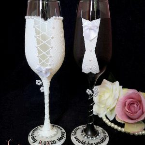 Bride and groom champagne flutes with black suit