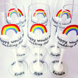 Postponed wedding rainbow champagne flutes